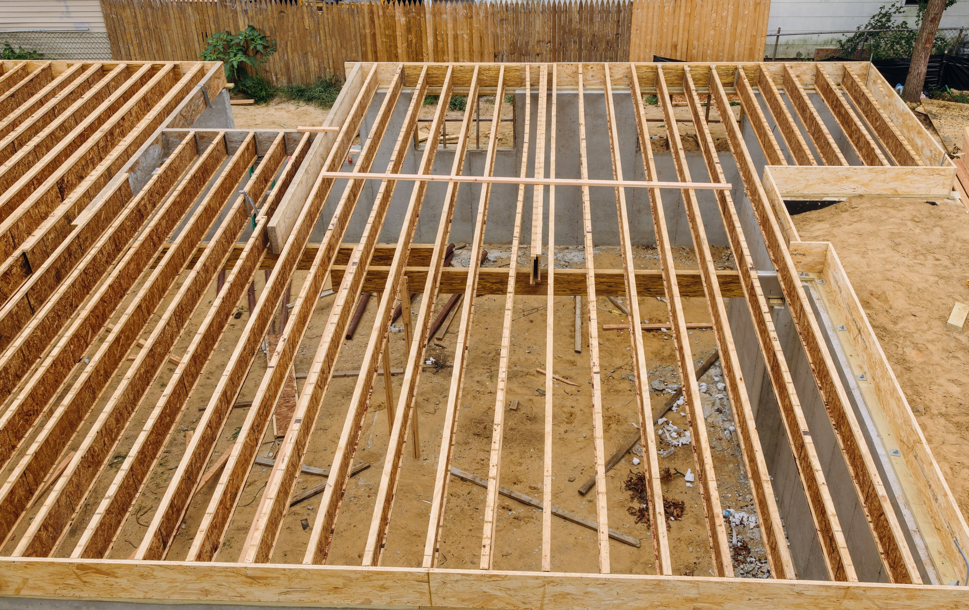 House framing floor construction showing joists trusses